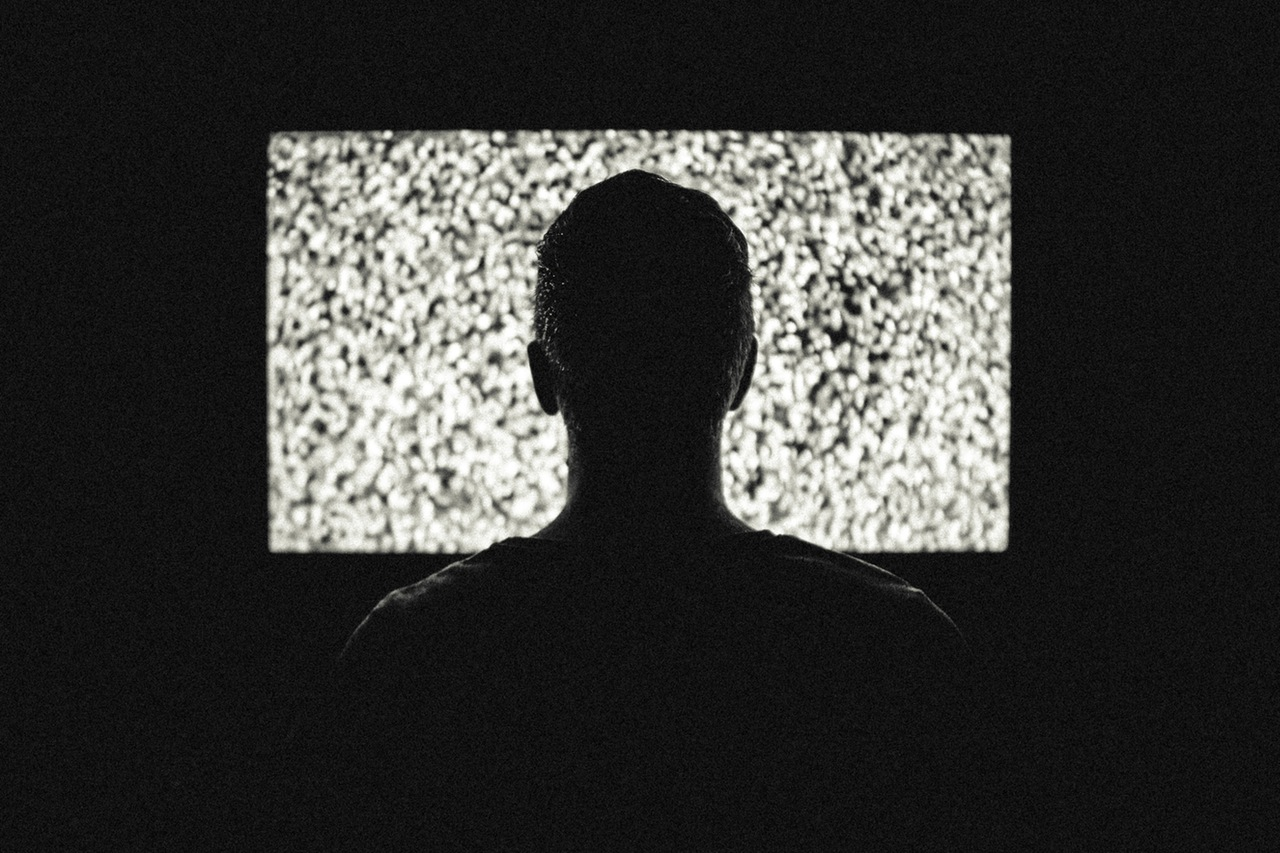 person watching static on screen